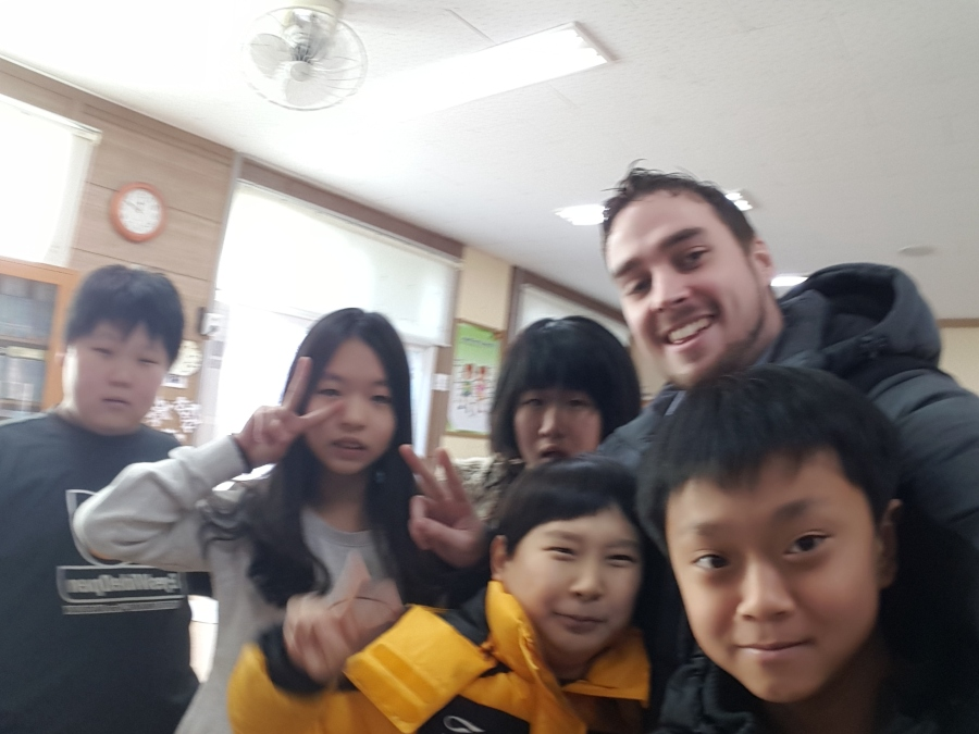 Me with some 6th grade students at Mulya Elementary School