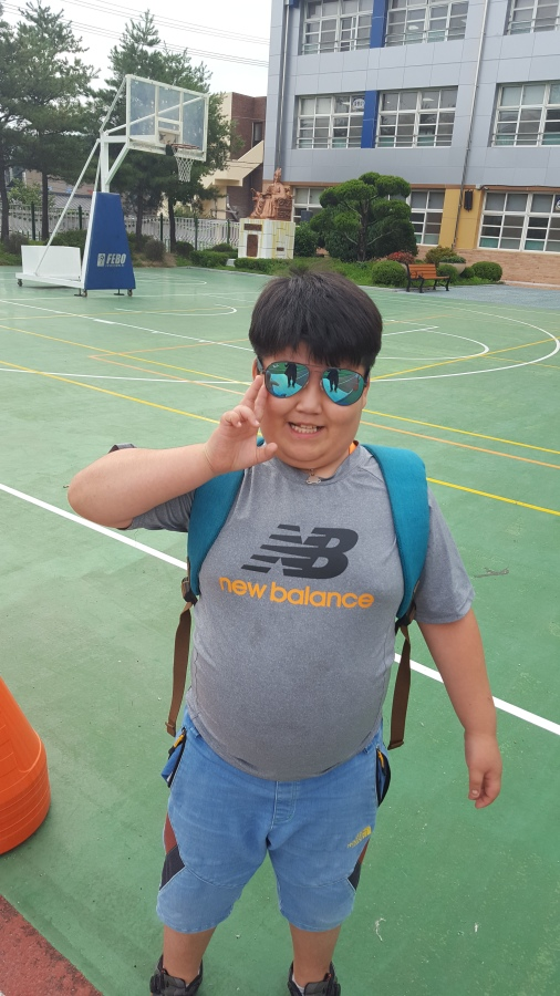 4th grade student Ji Su wearing my sunglasses