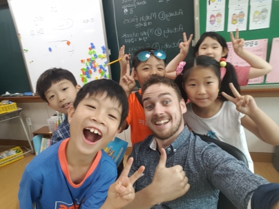 Me with some happy 3rd grade students at my main school