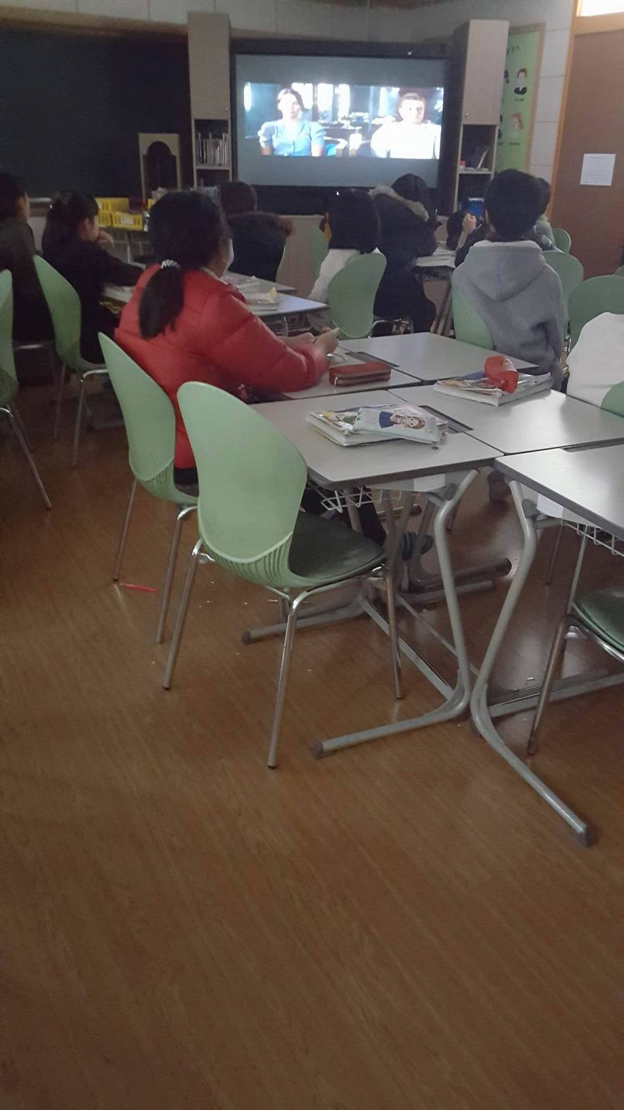 Isolated student sitting alone in the classroom